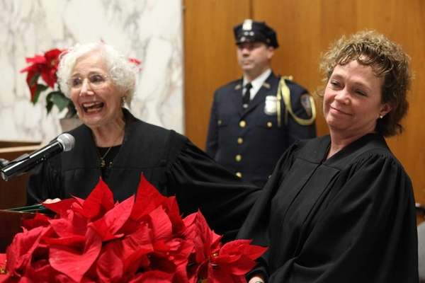 Retired Supreme Court Justice Zelda Jonas, left, gives