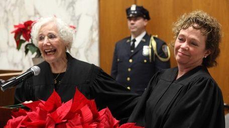 Retired Supreme Court Justice Zelda Jonas, left, gives