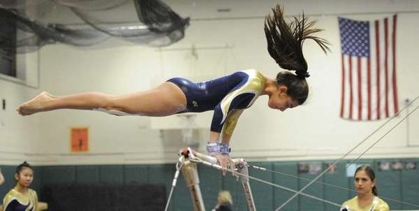 Bethpage gymnast Ashley Feliz competes on the uneven