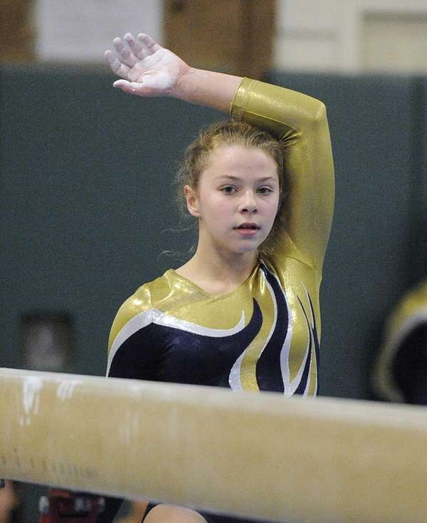 Bethpage gymnast Alyssa Firth looks on before she