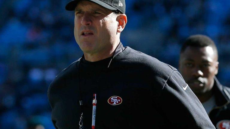 San Francisco 49ers head coach Jim Harbaugh runs