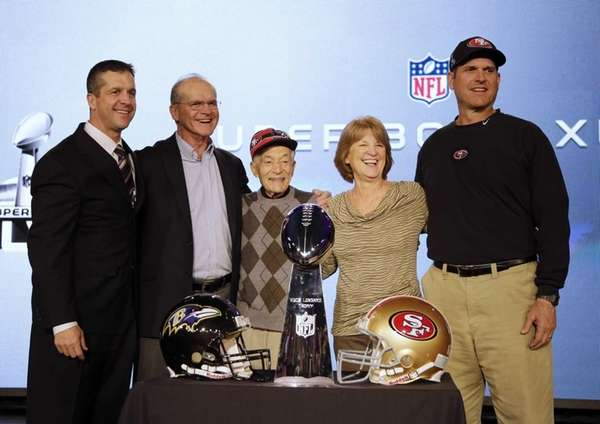 San Francisco 49ers head coach Jim Harbaugh, right,