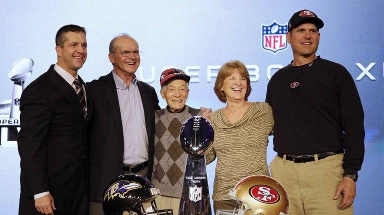 San Francisco 49ers head coach Jim Harbaugh, right,
