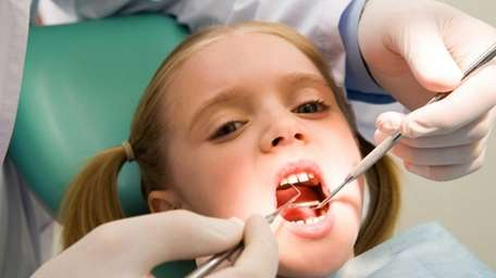 Children should get their first dental X-ray between