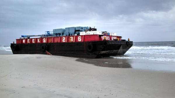 A tug towing a barge from Robert Moses