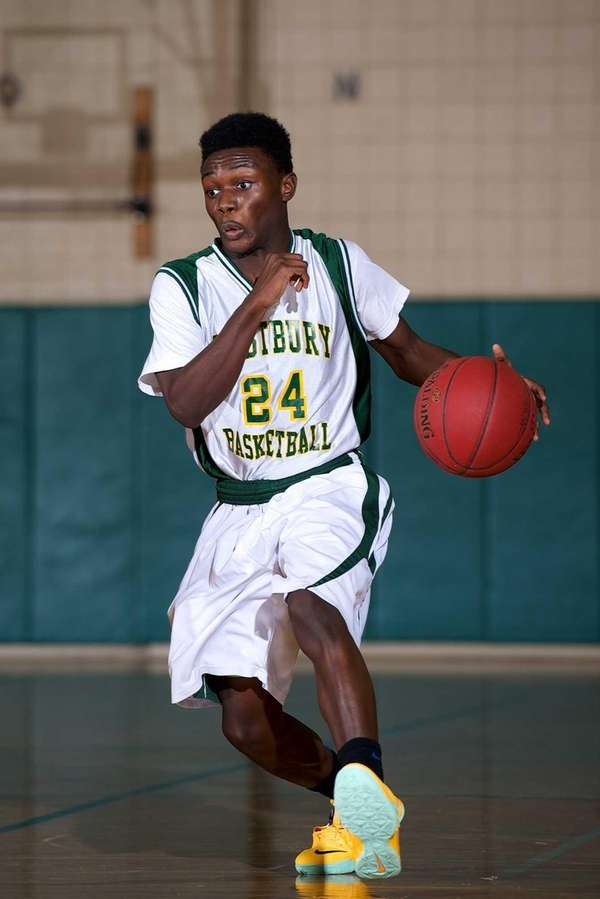 Westbury guard Jared Monah attempts to drive to