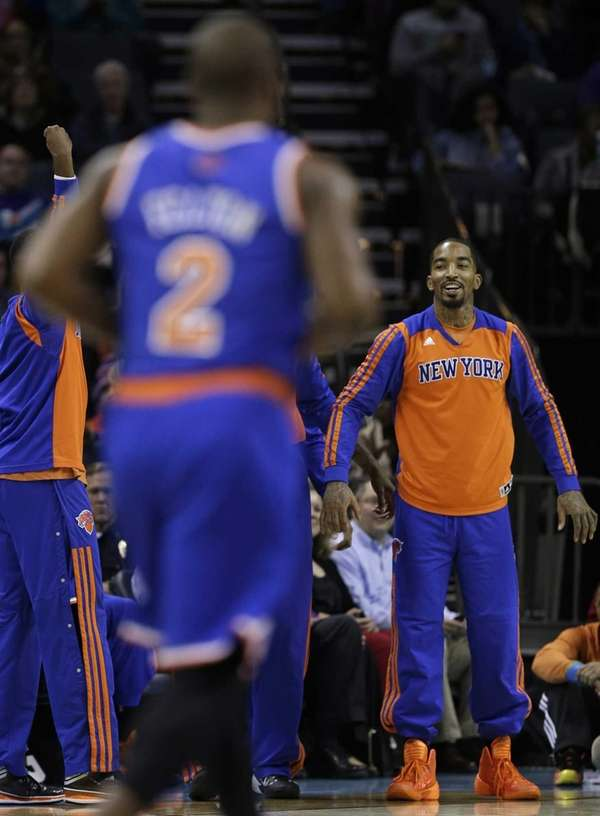 J.R. Smith, right, smiles after Raymond Felton (2)