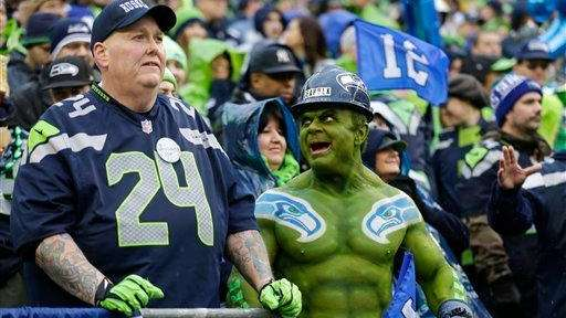 A Seattle Seahawks fan cheers during the first