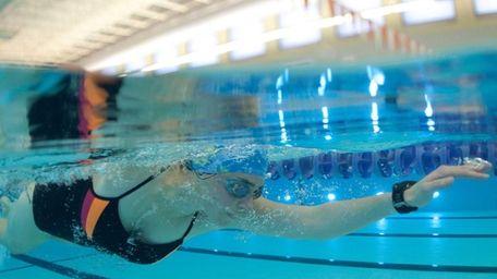 Dakota Lacey, 28, of Shoreham, swims laps in