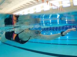 Dakota Lacey, 28, of Shoreham, swims laps in