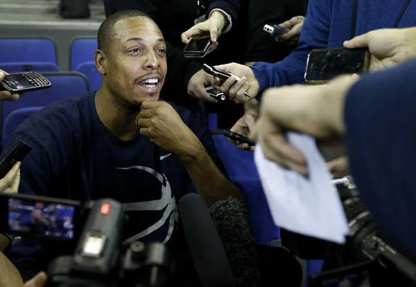 Paul Pierce is surrounded by media during a