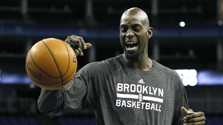 Nets' Kevin Garnett practices during a training session
