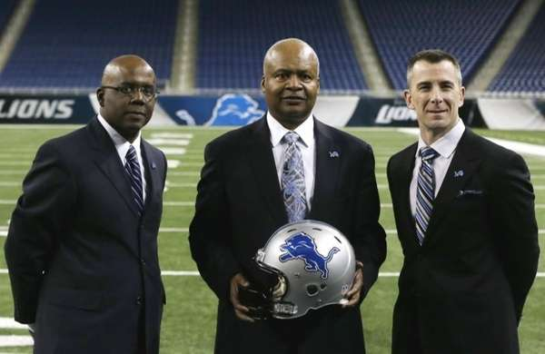 New Detroit Lions head coach Jim Caldwell, center,
