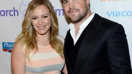 Hilary Duff and Mike Comrie attend the 7th