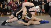 Glenn's Matt Porrello, top, wrestles Shoreham-Wading River's David