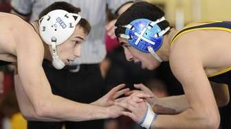 Glenn's Chris D'Amico, left, wrestles Shoreham-Wading River's Chris