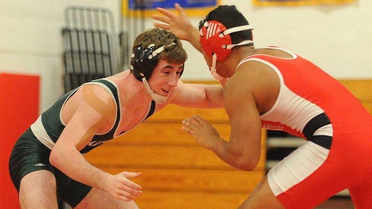 Locust Valley junior Sam Ward, left, battles Wheatley's