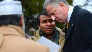 NYC Mayor Bill de Blasio comforts Osmon Nahian