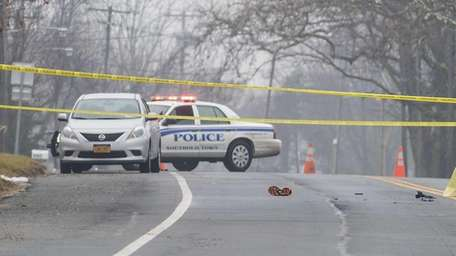 Police at the scene where a pedestrian was