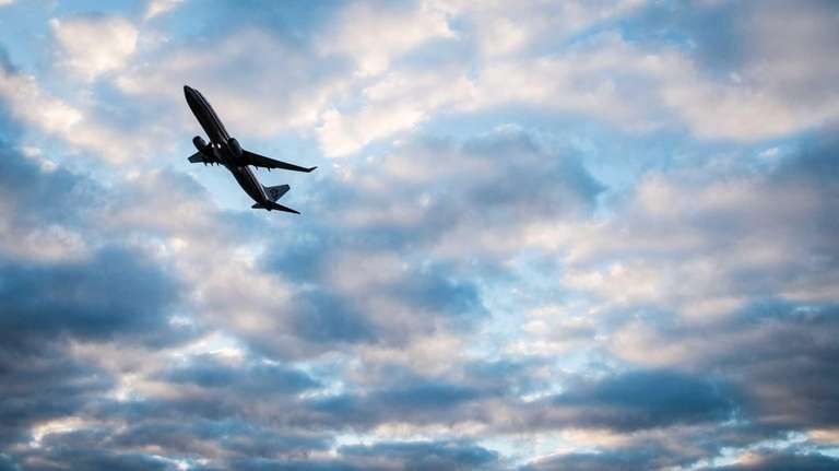 An airliner rises into the skies after takeoff