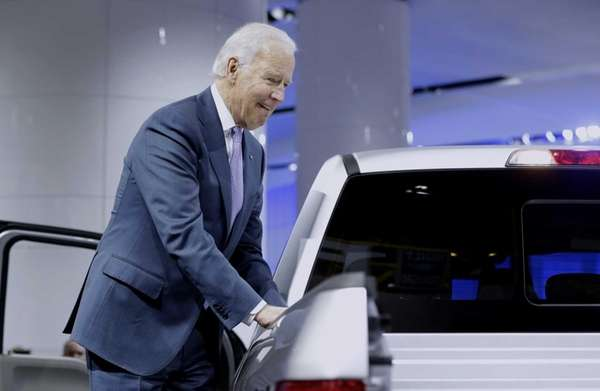 Vice President Joe Biden looks over a Ford