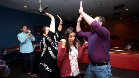 Romana Karim, of London, celebrates as Victoria Conte,