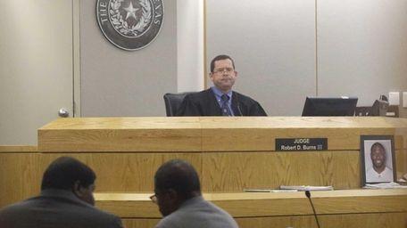Judge Robert Burns III looks on as Josh