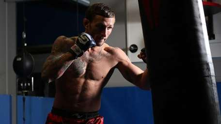 Gregor Gillespie trains with a punching bag at