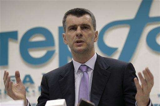 Russian billionaire Mikhail Prokhorov speaks at a news