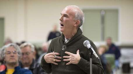 Ron Coons, of Laurel, speaks to the panel