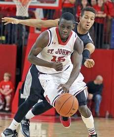 St. John's Sir'Dominic Pointer charges up the court