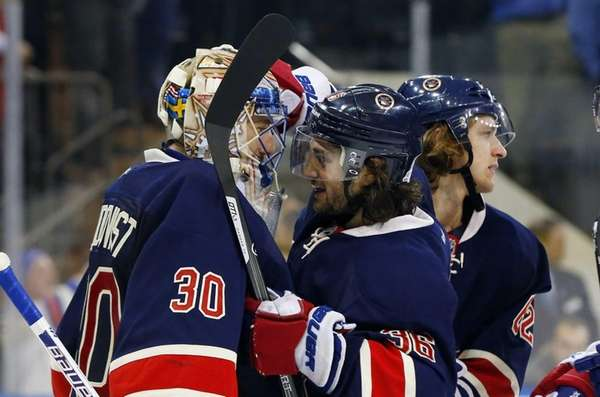 Henrik Lundqvist and Mats Zuccarello of the Rangers