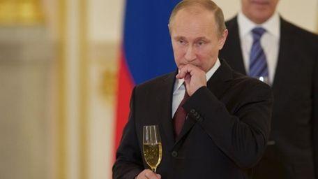 Russian President Vladimir Putin attends a ceremony of