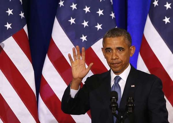 President Barack Obama waves to the audience after