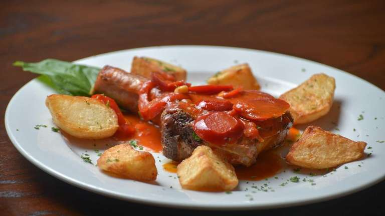 Pork chop is enlivened with cherry peppers, marinara