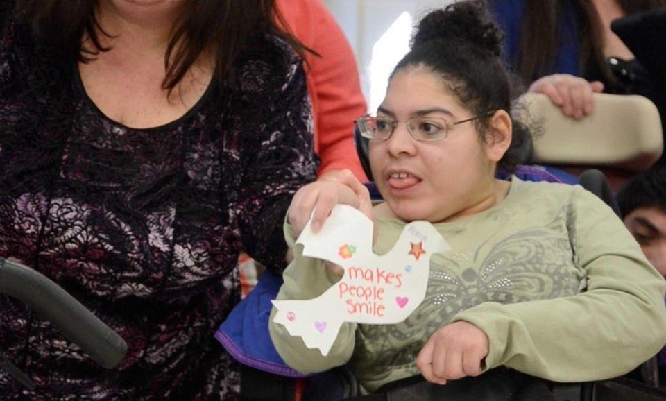 Mariah Corbitt, 17, of Hauppauge, holds a paper