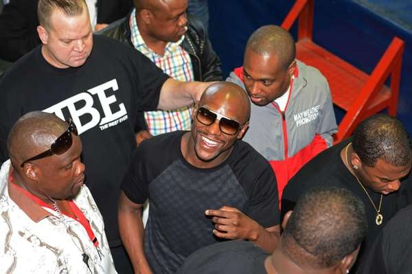 Floyd Mayweather Jr. greets fans during his visit