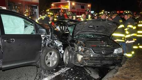 Firefighters work to extricate victims from the scene