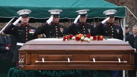 Marines salute the coffin of 19-year-old Marine Nicholas