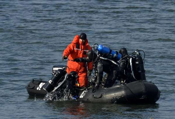 Police divers continue to search the East River