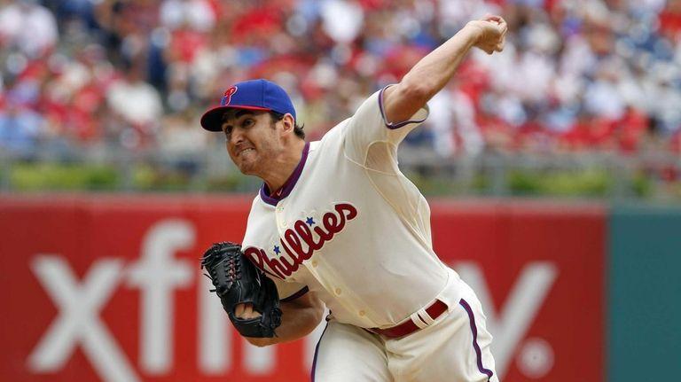 John Lannan throws a pitch against the Mets