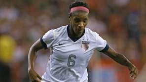 Defender Crystal Dunn of USA brings the ball