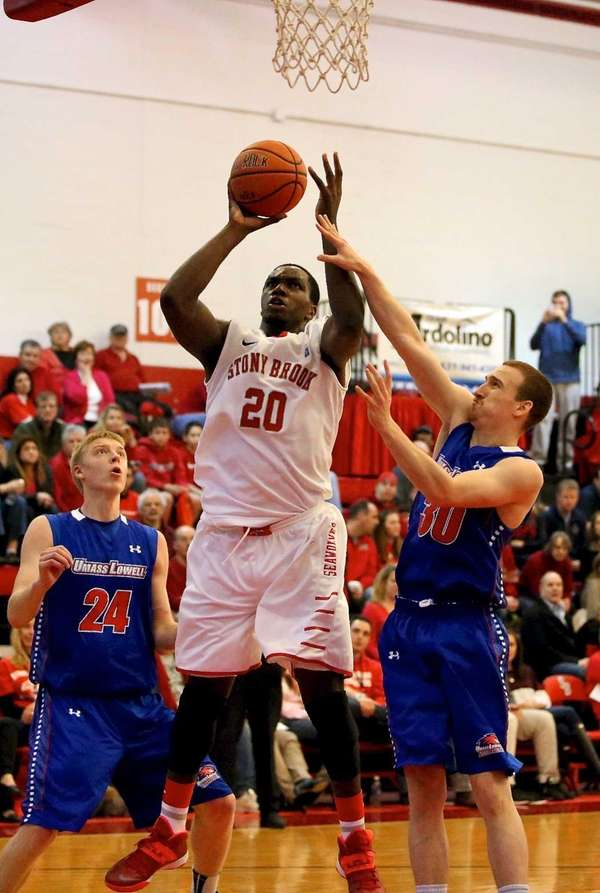 Stony Brook's Jameel Warney puts the shot in