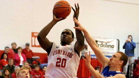 Stony Brook's Jameel Warney puts the shot in