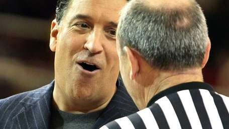 St. John's head coach Steve Lavin talks to