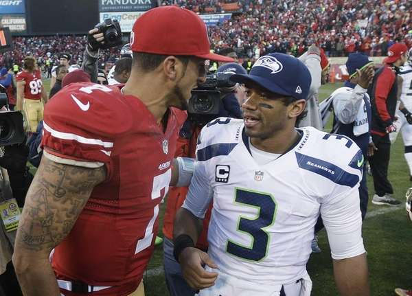 49ers quarterback Colin Kaepernick talks with Seahawks quarterback
