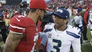 49ers quarterback Colin Kaepernick talks with Seahawks quarterback