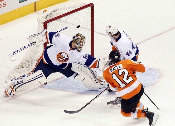 Philadelphia Flyers' Michael Raffl, right, scores the game-winning