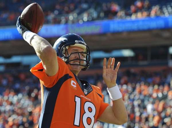 Denver Broncos quarterback Peyton Manning warms up before