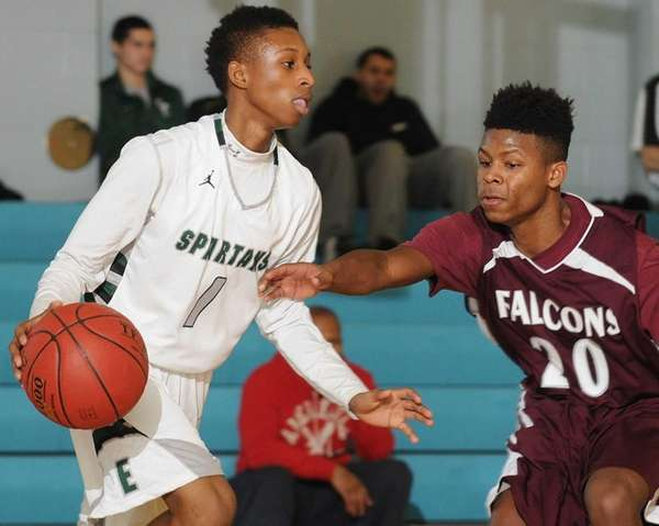 Deer Park's Angelo Riley, right, pressures Elmont's Keith